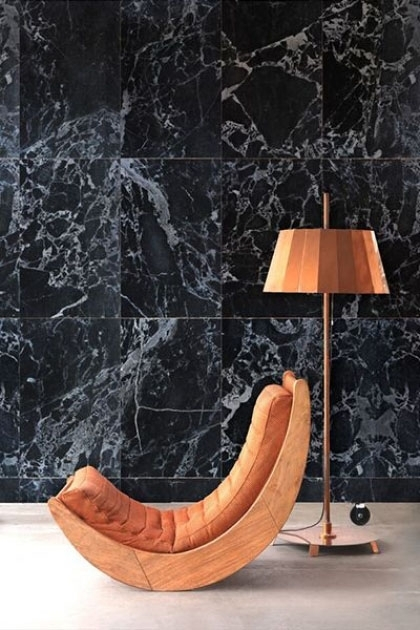 lifestyle image of NLXL PHM-51A Black Marble Wallpaper By Piet Hein Eek with orange chair and orange floor lamp