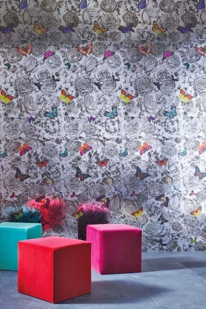 lifestyle image of Osborne & Little Butterfly Garden Silver Foil Wallpaper with red pink and blue cube pouffe's on grey flooring