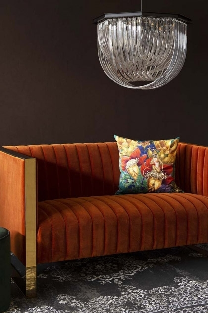 Lifestyle image of the Retro 50's Style Burnt Orange Velvet 2 Seater Sofa With Gold Trim with Opulent Crystal Pendant Ceiling Light and Exotic Jungle Velvet Cushion