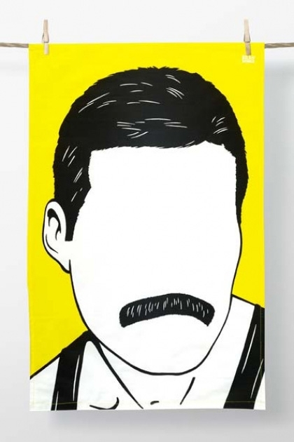 lifestyle image of Rock Icon Tea Towel - Freddie Mercury hung on string with wooden pegs and white wall background