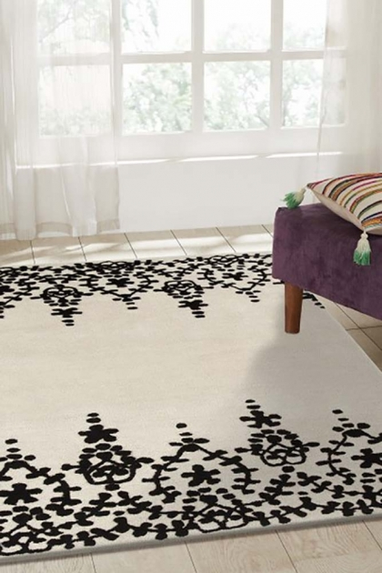 Lifestyle image of the Floral Lace Rug in Onyx Black