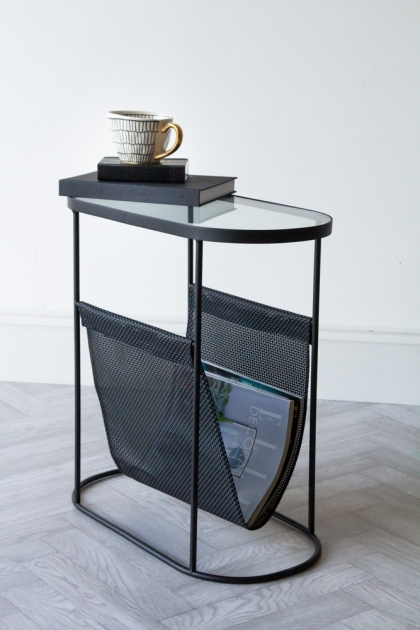 Lifestyle image of the Black Lozenge Shaped Glass Side Table With Magazine Rack