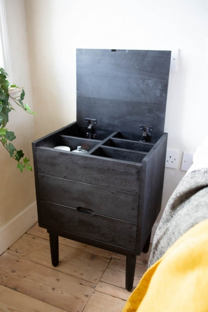 Angled lifestyle image of the Bureau-Style Black Mango Wood Bedside Table with the lid open