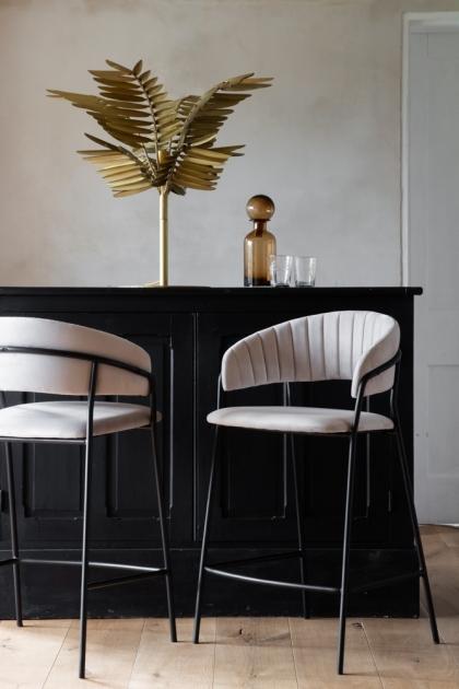 Lifestyle image of 2 Curved Back Velvet Bar Stools In Mink Grey, one facing front & one back