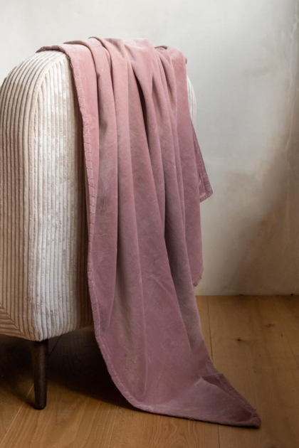 Lifestyle image of the Dusky Pink Velvet Throw