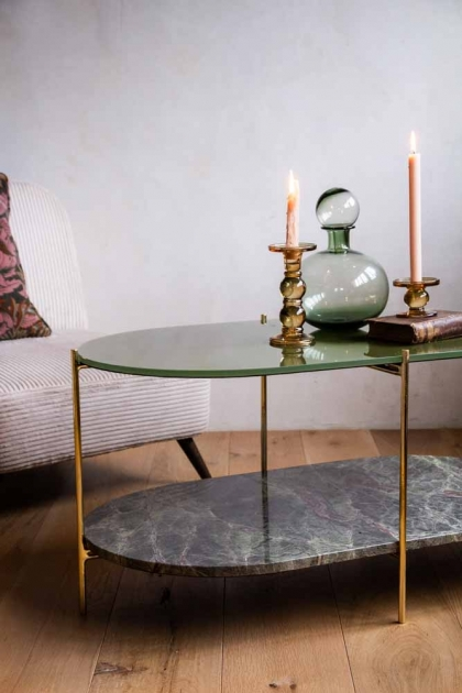 Angled lifestyle image of the Forest Green Oval Marble & Brass Coffee Table