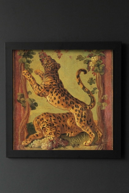 Image of the Framed Leopard Love Art Print hanging on the wall