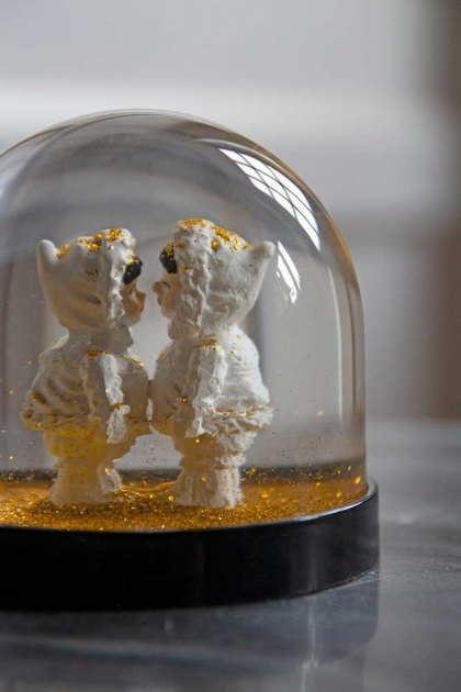 Close-up image of the Gold Eskimo Kiss Snow Globe