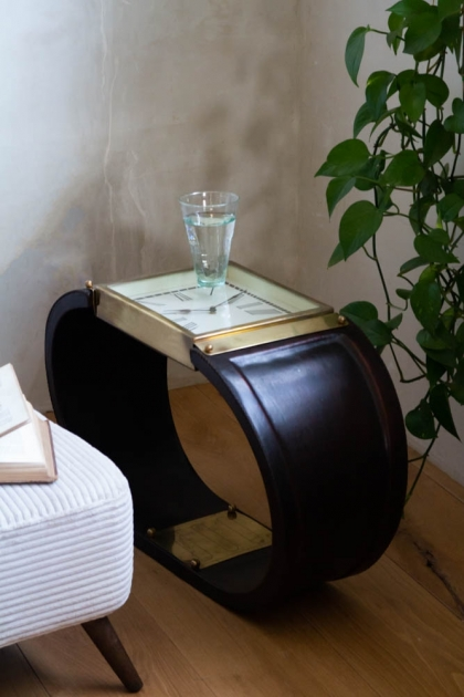Lifestyle image of the Spectacular Leather Watch Side Table / Stool