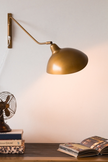 Lifestyle image of the Manhattan Gold Metal Directional Wall Lamp extended