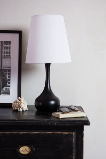 Lifestyle image of the Beautiful Black Wooden Table Lamp With White Lamp Shade
