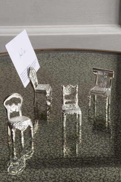 Close-up lifestyle image of the Set Of 4 Silver Chair Place Card Holders
