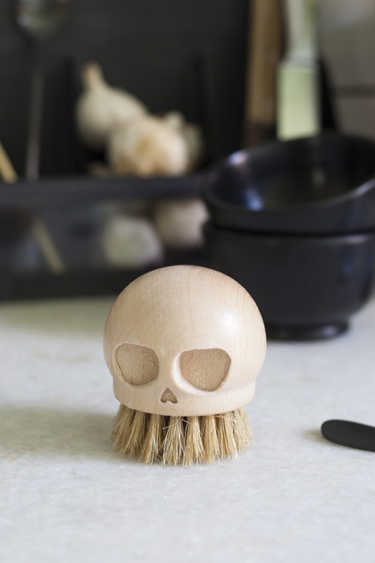 Image of the Wooden Skull Scrubbing Nail Brush standing on the bristles