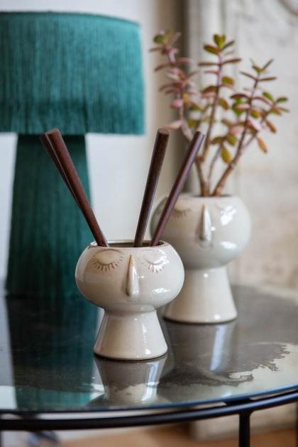 Lifestyle image of both sizes of the Sleeping Beauty Flower Pot