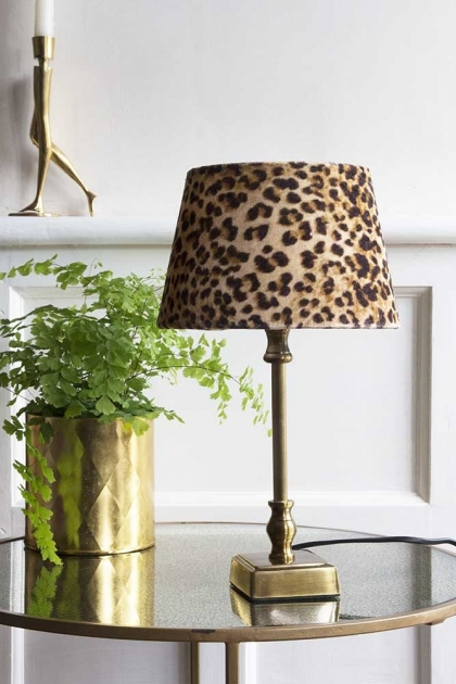 Lifestyle image of the Small Brass Traditional Table Lamp with Leopard Love Lamp Shade