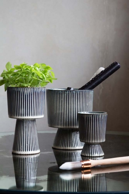 Lifestyle image of all 3 sizes of the Striped Goblet Pot