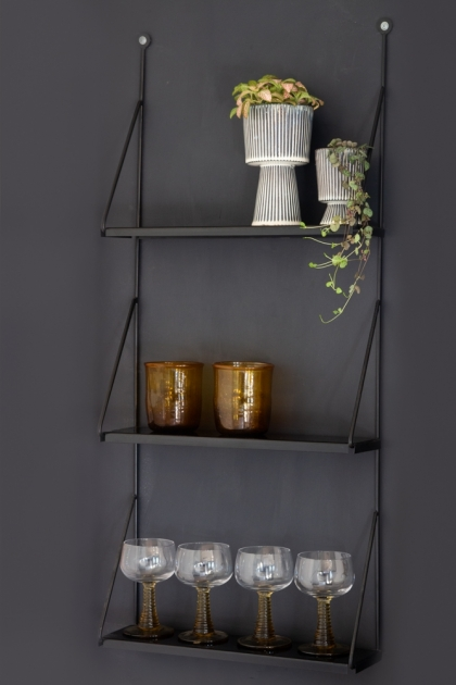Lifestyle image of the Three-Tier Black Metal Hanging Shelf on the wall