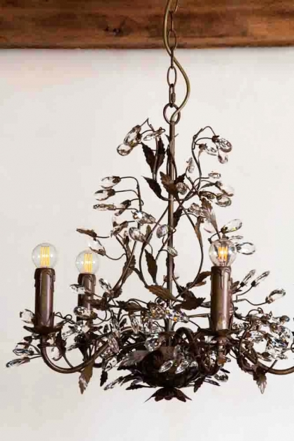 Lifestyle image of the Vintage Candle-Style Floral Droplet Chandelier