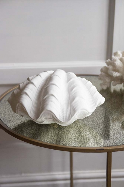 Lifestyle image of the front of the Porcelain Clam Shell Table Lamp
