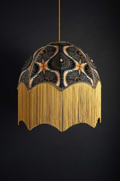 lifestyle image of Anna Hayman Designs DecoFabulous Gold & Black Bibana Pendant Shade turned off with dark wall background