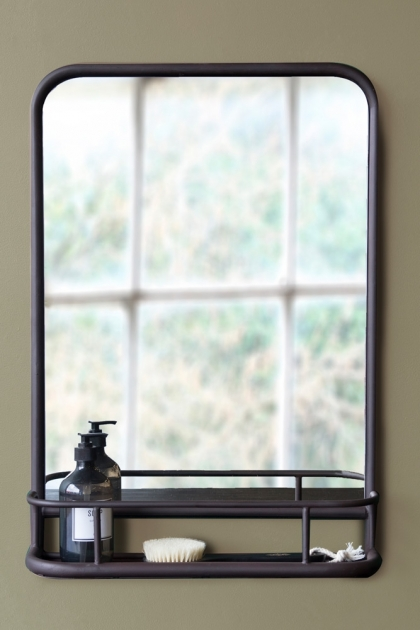lifestyle image of Dark Brown Mirror With Deep Shelf - Portrait with black soap dispenser in shelf hung on sage green wall background