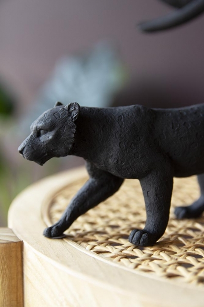 Close-up lifestyle image of the Black Stalking Leopard Ornament