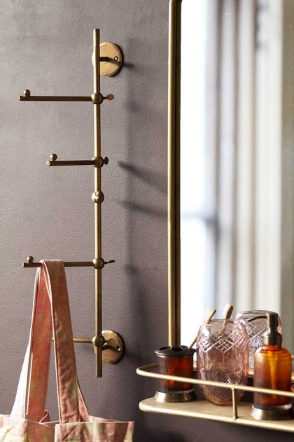 Lifestyle image of the Light Gold Vertical Coat Rack With Swivelling Pegs