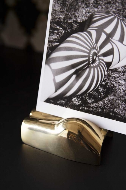 Lifestyle image of the Between The Cheeks Bottom Card Holder with black and white photograph and dark background
