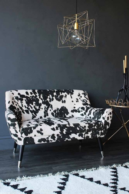 Lifestyle image of the Faux Cowhide Vintage Style 2 Seater Sofa