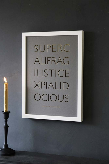 Lifestyle image of the Framed Supercalifragilisticexpialidocious Art Print in a white frame