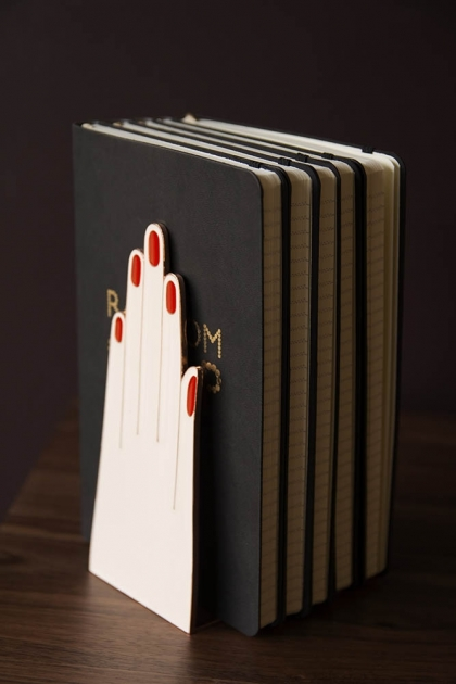 Lifestyle image of the Handy Hands Bookends with books