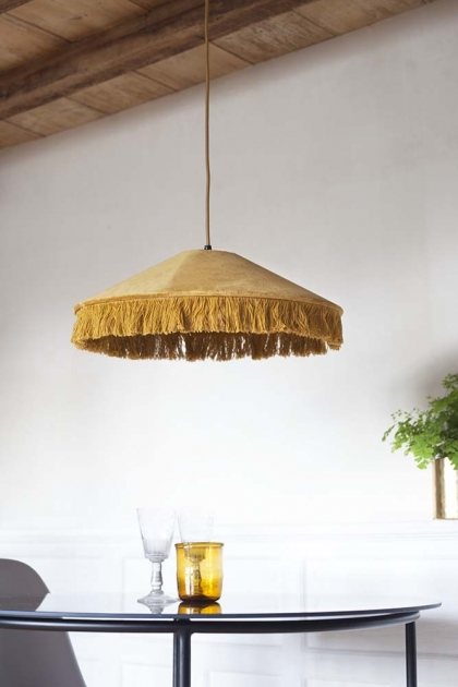 Lifestyle image of the Ecru Gold Conical Velvet Pendant Light With Fringe