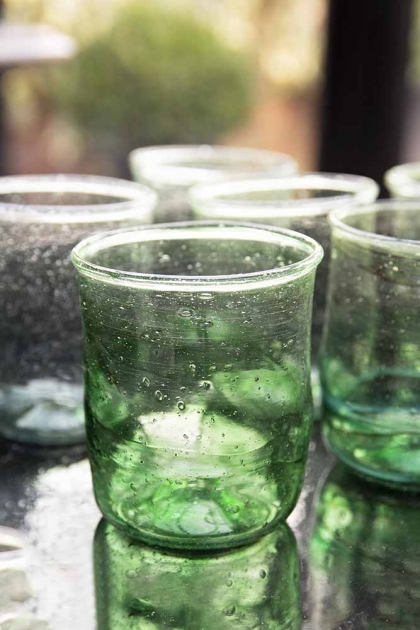 Close-up lifestyle shot of the green set of 6 recycled glass water tumblers