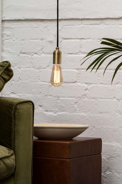 Lifestyle image of the E27 3W LED Dimmable Tinted Squirrel Cage Light Bulb
