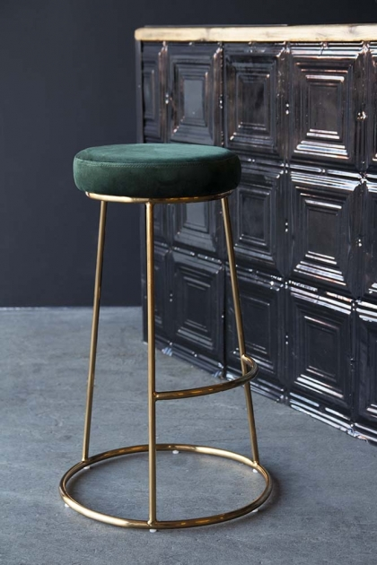 Lifestyle image of the Atlantis Velvet Bar Stool in Rich Green