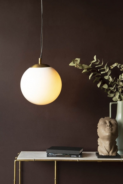 Lifestyle image of the Atlas Globe Pendant Light switched on