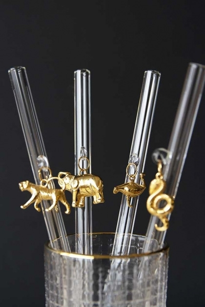 lifestyle image of Collection of 4 drinking straws in a glass showing all 4 golden animal charms