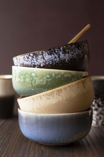 lifestyle image of stacked Set Of 4 Earthenware Bowls on wooden surface with other tableware