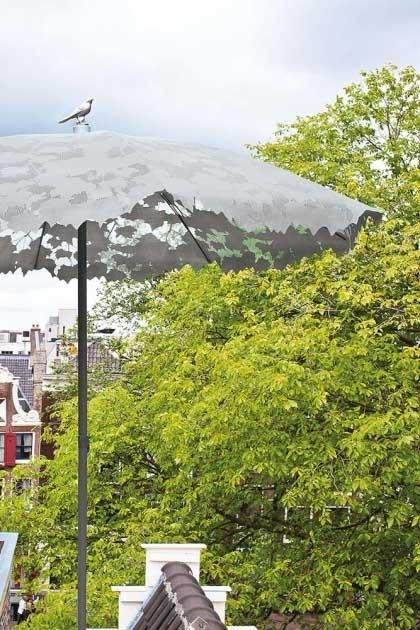 lifestyle image of Shadylace Parasol - Grey in outside setting