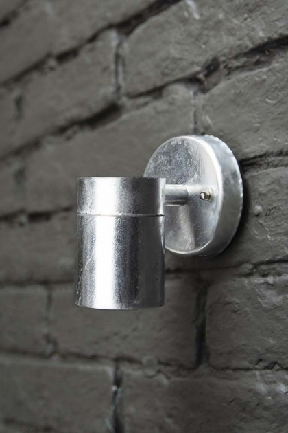 lifestyle image of St Ives Hot Dipped Down Wall Light - Small on grey brick wall background