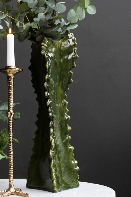 lifestyle image of Texas Cactus Vase with eucalyptus in on white side table with gold bird foot candlestick