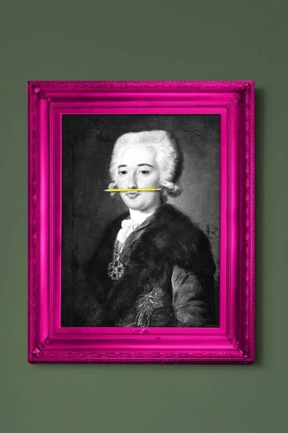 lifestyle image of The Yellow Pencil Canvas with Printed Frame black and white portrait with yellow pencil in mouth and pink frame on green wall