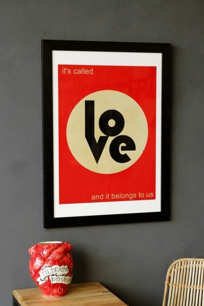 lifestyle image of Thieves Like Us - New Order Art Print - Choose Framed Or Unframed in black frame above wooden side table with red heart vase and grey wall background