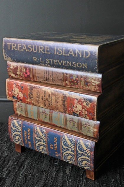 lifestyle image of Treasure Island Book Chest Of Drawers  Bedside Table on dark wooden flooring and dark grey wall background