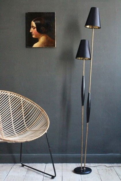 lifestyle image of Twin Reed Floor Lamp With Golden Shades with round rattan chair and portrait hung on grey wall background