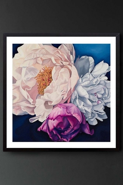 Lifestyle image of Unframed Art Print By Amy Carter Stay Wild multi-coloured flowers on navy background hung on dark grey wall