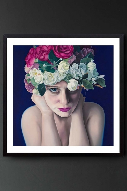 lifestyle image of Unframed Art Print By Amy Carter When You're Gone woman with white pink and green flower crown on purple background inblack frame hanging on dark grey wall