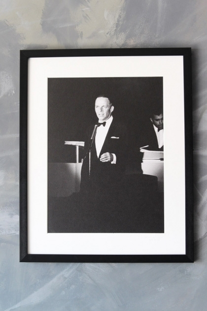 lifestyle image of Unframed La Galerie Photo - Frank Sinatra black and white photogrpah in black frame on distressed grey wall background