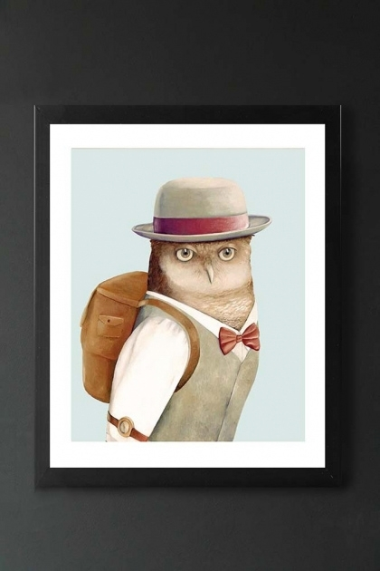 lifestyle image of Unframed Mr Owl Fine Art Print owl in suit with bow tie, hat and backpack in black frame on dark wall background