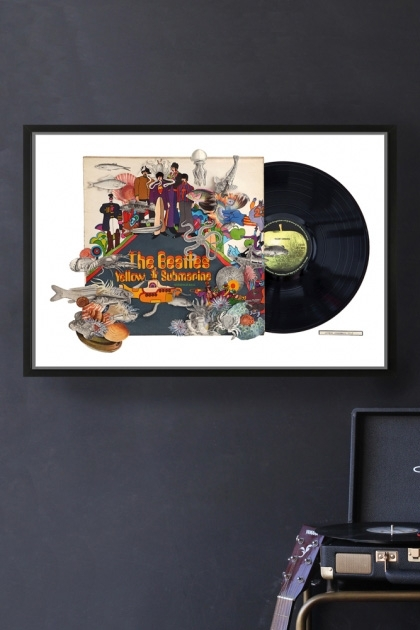lifestyle image of Unframed The Beatles Yellow Submarine Record Cover Collage by Alison Stockmarr in black frame with record player and grey wall background